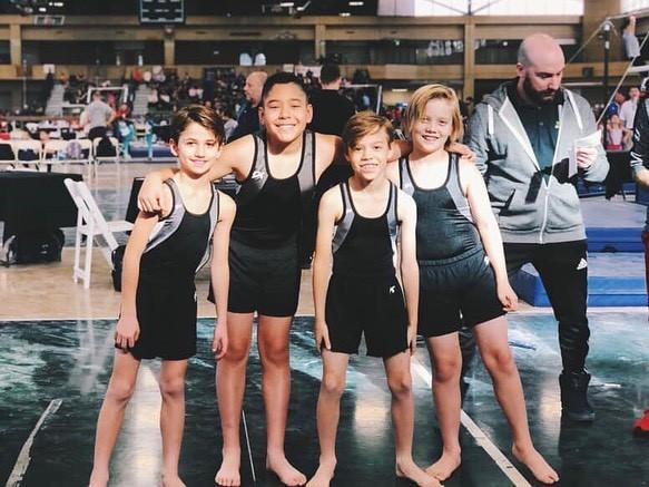 Industry Gymnastics Boys Team huddle