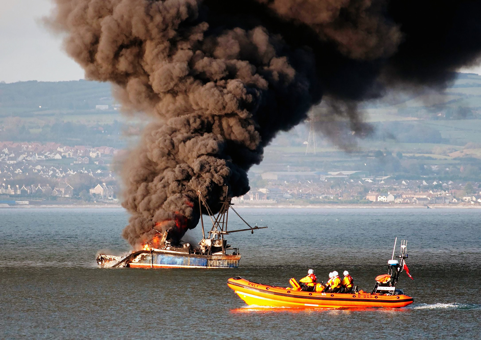 COLOUR - Fishing Boat Fire In Belfast Lough by Danny McCaughan (11 marks)