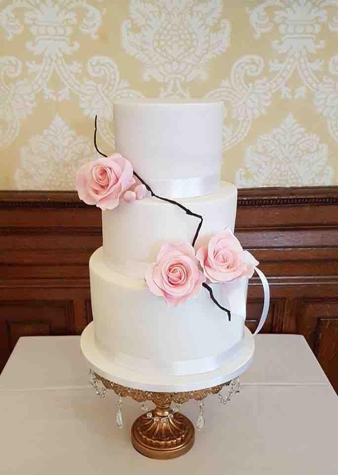 Simple White Wedding Cake with Pink suga