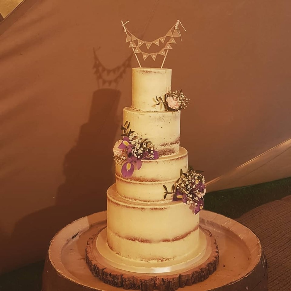 4 tier Semi naked wedding cake Tipi