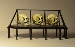EXHIBITION CASE WITH OVERSIZED SKULL
