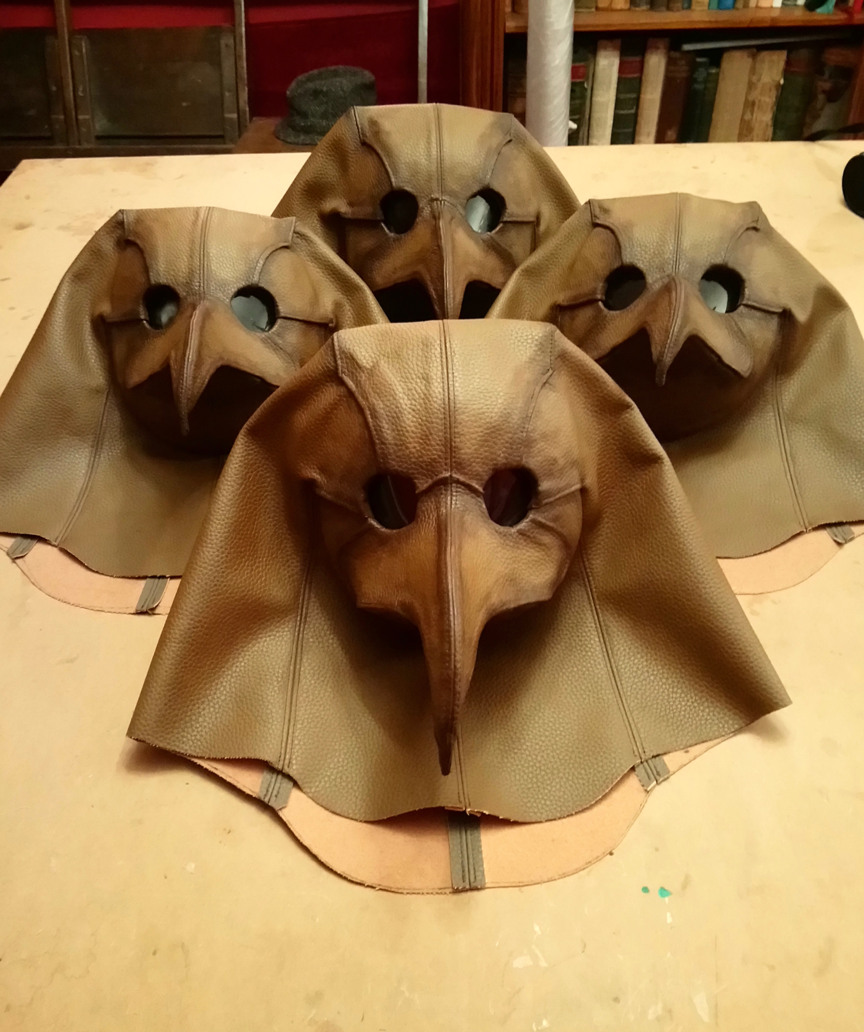 Four finished plague masks