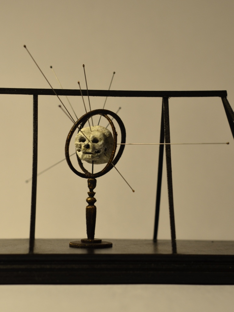 SKULL IN MEASURING DEVICE