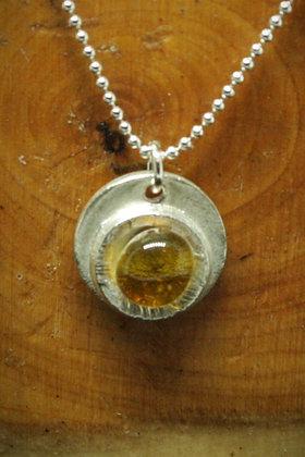 4019 - Yellow glass cabochon on silver circle