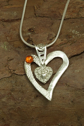 3069 - Assymetric heart with amber cabochon