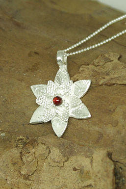 6296 - Flower with double petals and red garnet centre