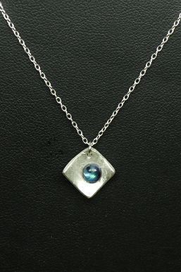 4967 - Curved diamond shape with bluey-green cabochon