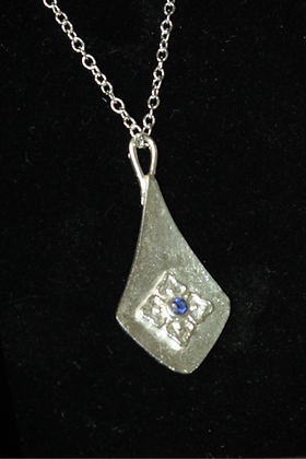 2958 - Teardrop with flower and blue stone