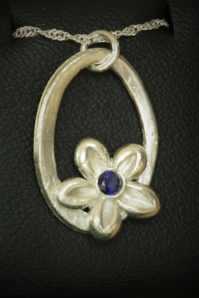 3127 - Flower with blue stone on oval ring