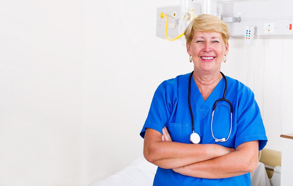 bigstock-Happy-senior-nurse-standing-wi-14764088 copy 2.jpg