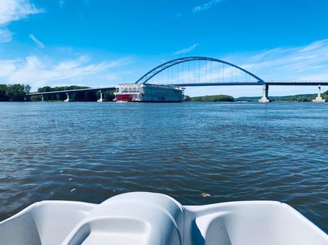 Queen of The Mississippi as she crosses under The Dale Gardner Veterans Memorial Bridge