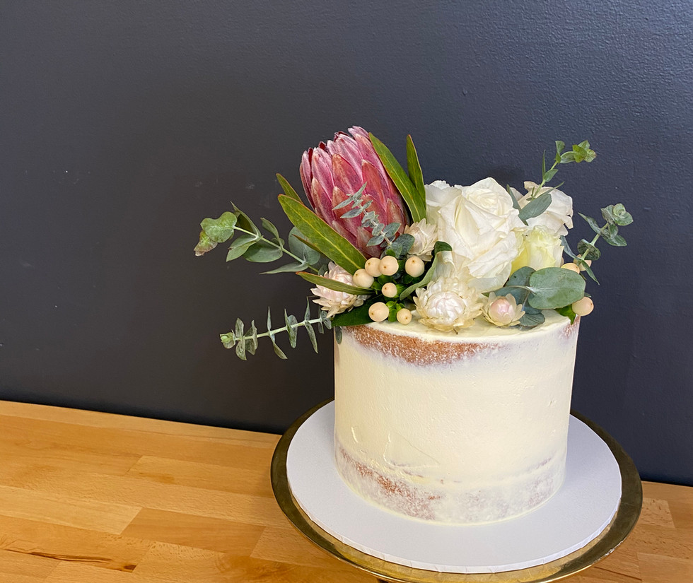 native florals on a semi naked cake
