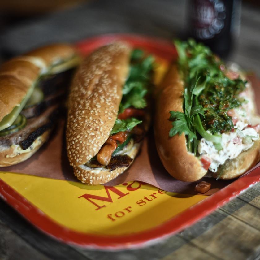 Three sandwiches on a platter.