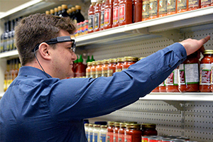 A research participant wears eye-tracking glasses as he chooses grocery items in the Longo's Food Retail Lab.