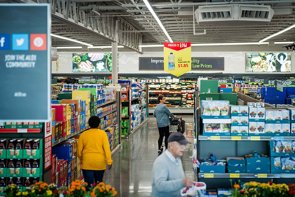Image of consumers walking through a Aldi grocery store in the United States.
