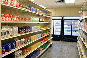 A short aisle in the mock grocery store with dry goods on the shelves.
