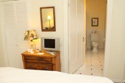 Bedroom with light cream walls