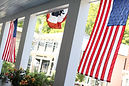 American flags and bunting hanging on porch