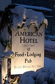American Hotel outdoor sign: Food, Lodging, Pub