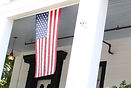 American flag on porch