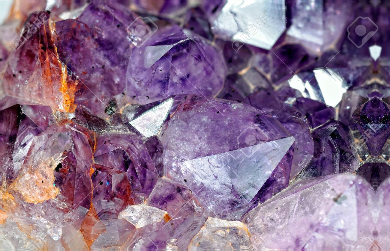 11061952-Close-up-view-to-raw-amethyst-crystals-Studio-shot-with-ring-flash-Stock-Photo