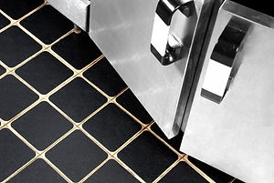 Resilient_black_pieces_on_tiles.jpg