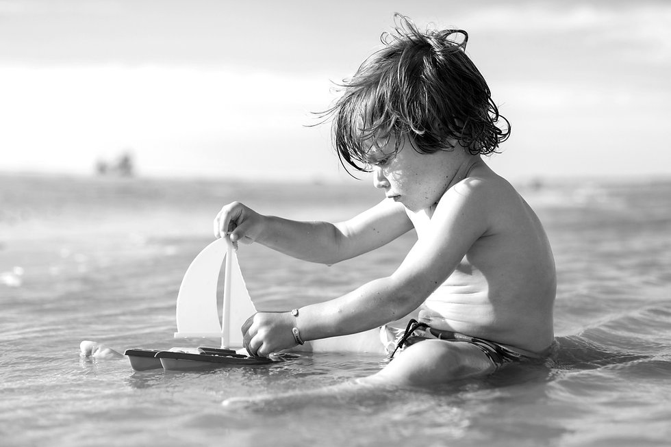 Boy%20Playing%20with%20Toy%20Boat_edited