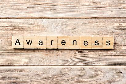 awareness word written on wood block. aw