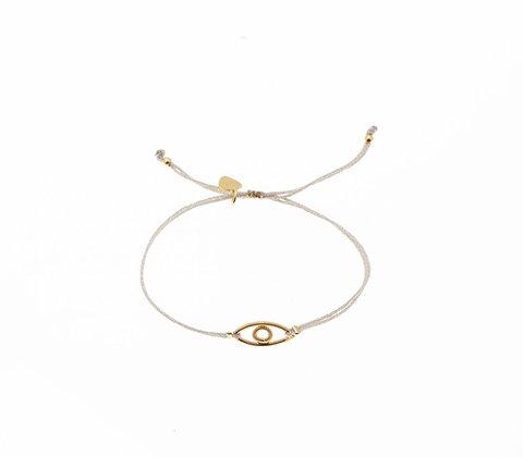 Bracelet cordon lurex , apprêt Oeil plaqué or