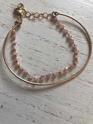 Double bracelet , doré et rose clair