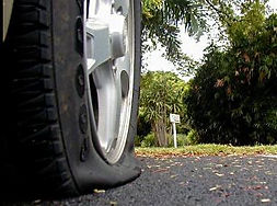 flat tire on road