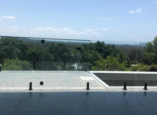 Glass Fencing highlighting Black Spigots