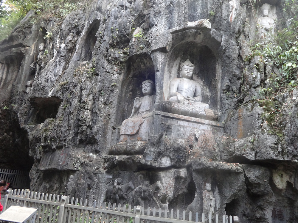 Buddha's carved into the foot of a mountain