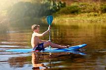 Boy paddling a float board