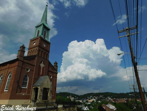 One of Cumberland's Beautifully Designed Churches With a Cauliflower Thunderhead in the Distance
