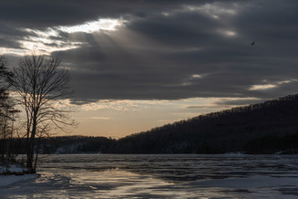 Clouds Roll Over Ice-Covered Lake