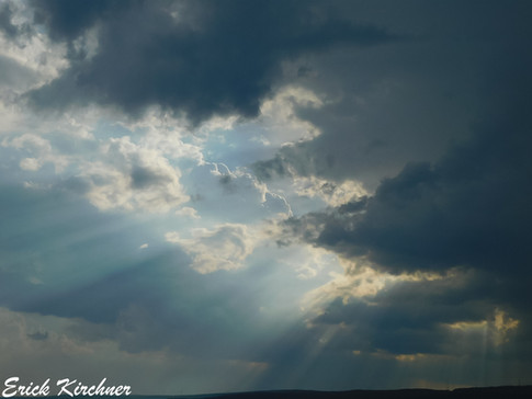 Brilliant Sun Rays Shining Through Storm Clouds Over Eckhart Mines, MD