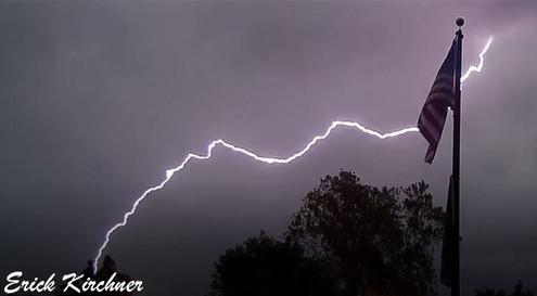 Lightning Bolt Striking Behind the American Flag in Branson, MO