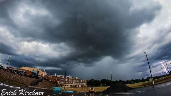 A Thunderstorm Discharging a Powerful Lightning Bolt Over Allegany High School in Cumberland, MD