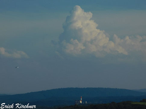 A Pop-Up Shower Developing to the South of Mexico Farms and a Plane Flying Through the air Looking From Cumberland, MD