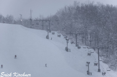 The Wisp Resort in Full Operation on a Snowy Day at Deep Creek Lake