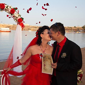 Red passion wedding on the beach