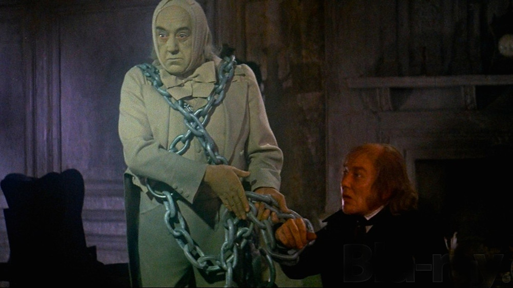 Jacob Marley (Alec Guinness) reminding Scrooge that he built his fate, link by link.