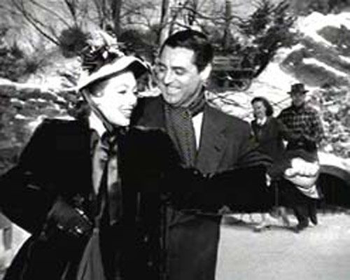 "Loretta Young and Cary Grant take to the ice in ""The Bishop's Wife."""