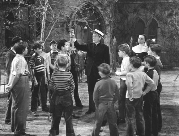 Crosby as the priest who knows how to relate with kids.