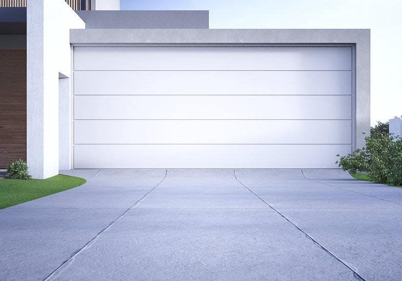 modern-house-big-garage-with-concrete-dr