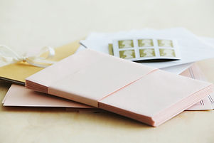 Pink envelopes and postage stamps