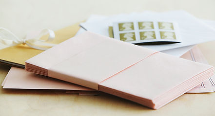 stack of envelopes with stamps & stationery