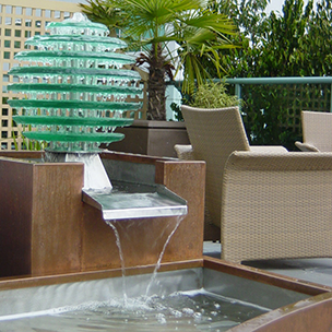 copper and glass water feature