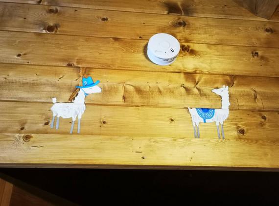 Alpaca murals above door to bunk room